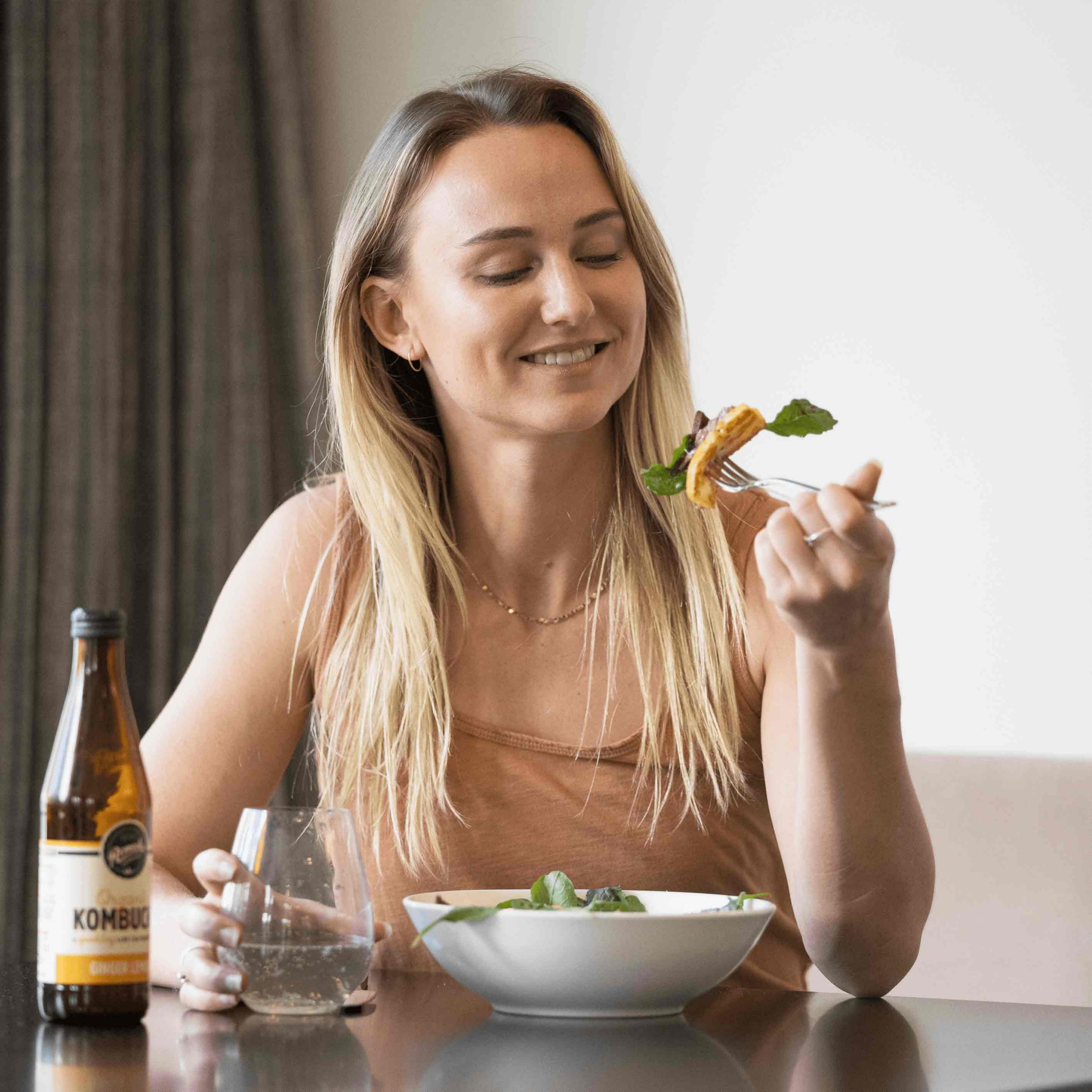 Nutritionist eats dinner at a table